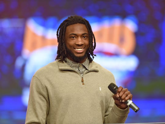 Mike Williams speaks during the Coaches4Character event in Greenville on March 27. Williams was selected by the San Diego Chargers in Thursday's first round of the NFL draft.