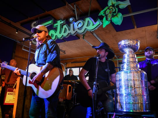 Billy Ray Cyrus sings to the Stanley Cup during its