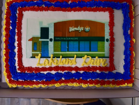 A cake celebrating the reopening of a remodeled Wendy's