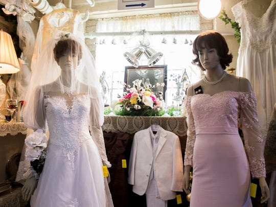 A special seasonal selection of bridal attire for sale at St. Vincent's Thrift Shop in Hanover on May 7, 2018.