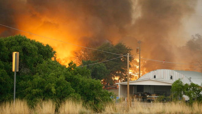 Homes burn as the Yarnell Hill Fire encroaches property in Glenn Ilah, Ariz., on Sunday, June 3 2013, near Yarnell.