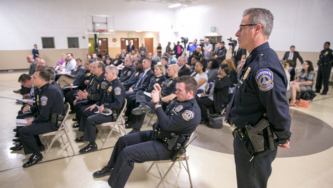 Law enforcement officers, journalists, and community members, at the Indanapolis Metropolitan Police Department Stewardship Report, Indianapolis, Monday, Feb. 26, 2018.