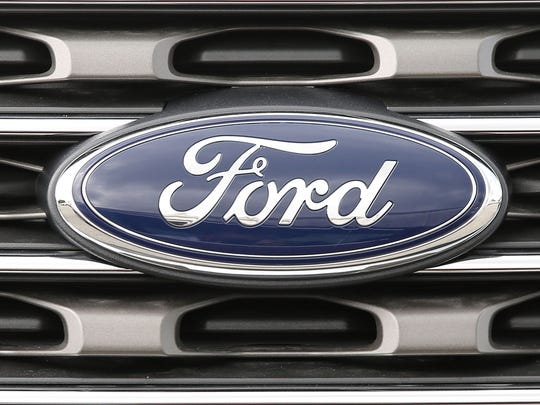 A Ford vehicle is seen on a dealership's lot on May 16, 2017 in Miami, Florida.