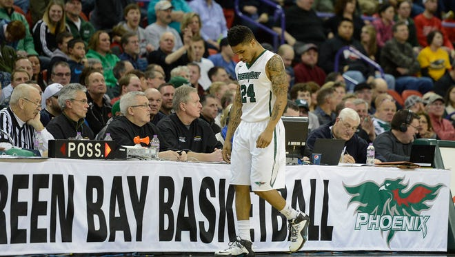 UWGB's Keifer Sykes walks off the court after committing his fourth foul against UW-Milwaukee at the Resch Center in Ashwaubenon.