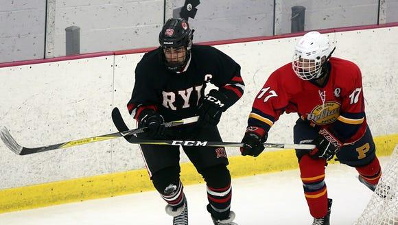 Pelham's Drew Montanarella (17) Rye's Alex Noga (23)