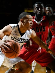 Vanderbilt guard Larry Austin Jr. (3) drives past Austin