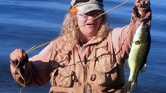 Carol finally landed her first New Hampshire bass.
