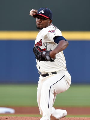 Braves starting pitcher Julio Teheran pitches against the Mets during the first inning at Turner Field.