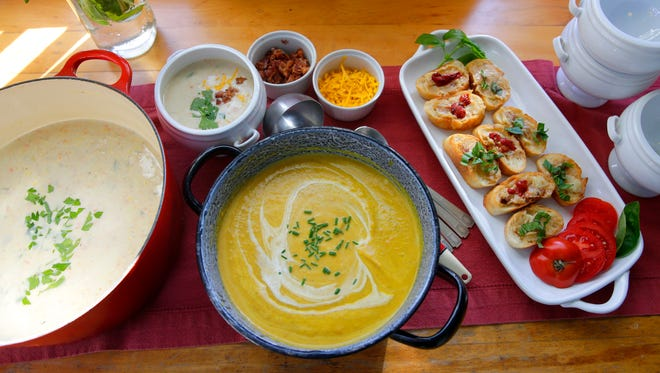 The lineup for a fall soup and movie night (from left): Perfect Potato Soup, Curried Butternut Squash Soup and Garlic Crostini with Assorted Toppings.