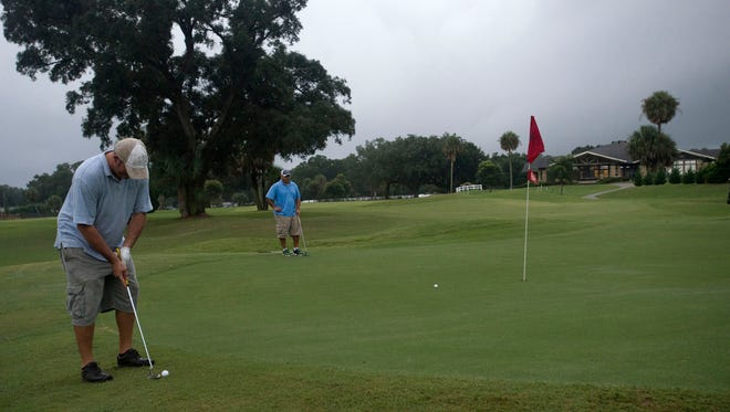 Kris Keller, left, and Bobby Pinder, right, plays a round of golf at Osceola Golf Course on a soggy Friday morning. City taxpayers have been subsidizing the Osceola Municipal Golf Course for an average of roughly $200,000 a year for the last five years. One city councilman says the course should be sold, but members of the golfing community say it provides a low-cost, public alternative to other courses in the area.
