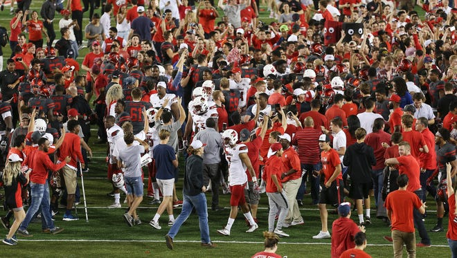 U of L's football players got caught in the rush of University of Houston fans as they rushed the field after defeating U of L 36-10 at Houston.Nov. 17, 2016
