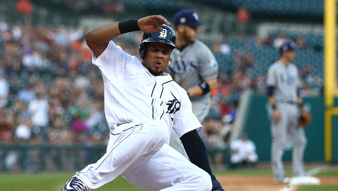Detroit Tigers' Jeimer Candelario slides in for a run in the third inning while playing the Tampa Bay Rays at Comerica Park on May 1, 2018.