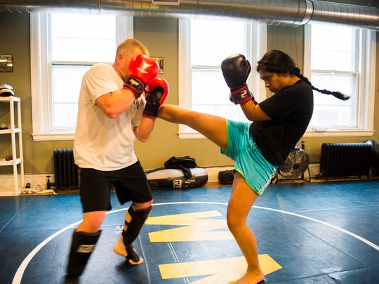 Lucero Ramirez, of Gettysburg, works on kickboxing sparring with Larry Curry of New Oxford on April 7, 2016 at Hanover Boxing Club on Carlisle Street. Ramirez has been attending classes for five months with Joe Dressel and Hanover Boxing Club.