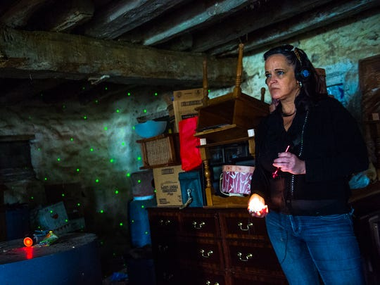Brigid Goode, with Gettysburg Ghost Gals, uses a recorder to try to capture EVP, or electronic voice phenomena, at the David Stewart Farm on May 21, 2016