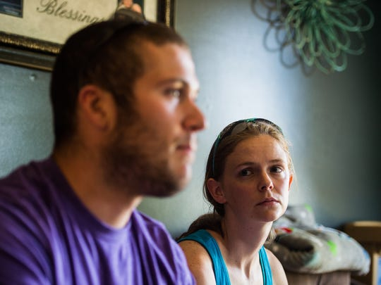 Tara Engelhart, 28, listens to her husband Breighton, 24, recount his memory of the car crash he was involved in in June. Breighton was removed from his truck and airlifted by helicopter to York Hospital with multiple fractures.