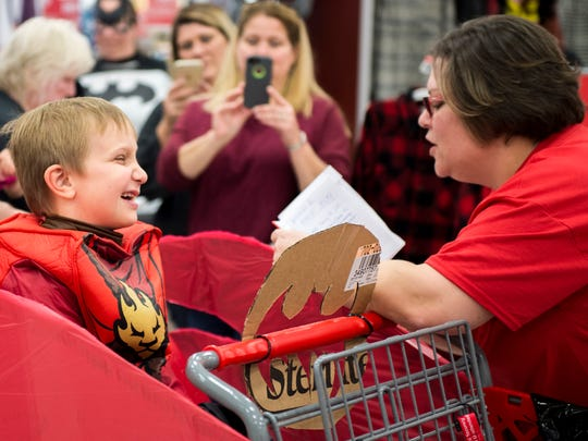 Gunnar Downie listens to Jessica Doubell explain to him what his mission is before he can go on his shopping spree on Sunday, Oct. 16, 2016 at Target in Chambersburg, Pa.