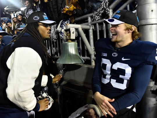 Penn State's Blake Gillikin, right, rings the victory bell with Paris Palmer after a 2016 victory over Michigan State clinched the Big Ten East title.