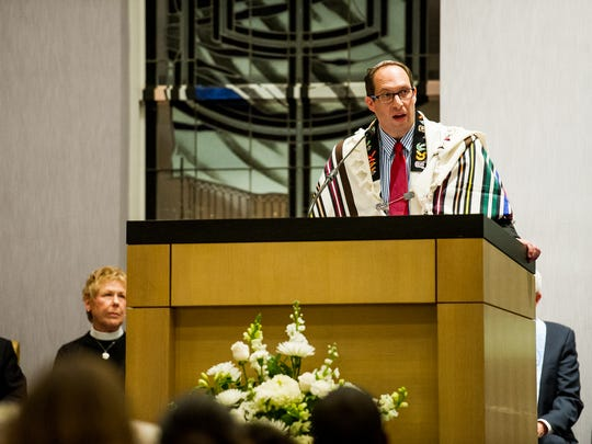 In this 2016 file photo, Rabbi Adam F. Miller speaks to a crowded room during an event in favor of solidarity at the Temple Shalom in Naples, Fla.