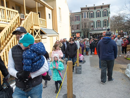 Locals and residents from other areas come out to visit IceFest in downtown Chambersburg in January 2017.