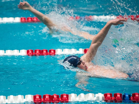 Chambersburg's Avery Barley swims the boys backstroke during the Mid Penn swimming championships at Cumberland Valley on Saturday, Feb. 11, 2017. Barley took second place in the boys 100 yard backstroke.