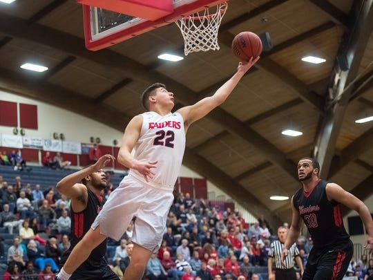 Shippensburg's John Castello (22) puts up a short shot during a PSAC quarterfinal playoff game against East Stroudsburg at Heiges Field House on Wednesday, March 1, 2017 in Shippensburg, Pa.  The Raiders defeated ESU, 85-71.