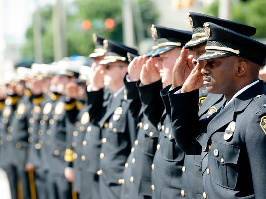 Montgomery Police Officers salute as the colors are presented during a the Montgomery Police 2017 Memorial Day Service on Wednesday, May 17, in Montgomery, Ala., The service was held in memory of the 28 fallen officers who have died in service of Montgomery.