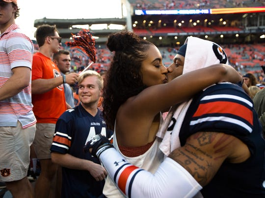 Auburn defensive back Tray Matthews (28) kisses his girlfriend, Tiffany Lewis, after the NCAA Football game between Auburn and Mercer on Saturday, Sept. 16, 2017, in Auburn, Ala. Auburn defeated Mercer 24-10.