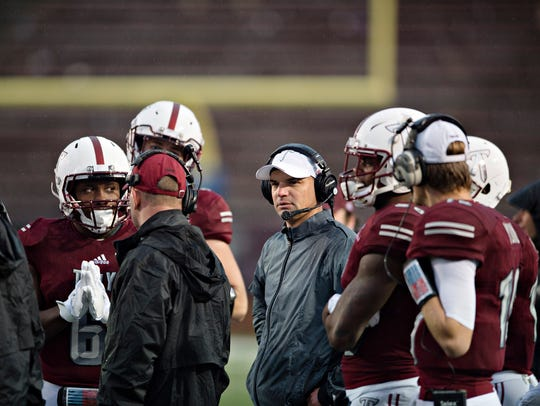 Troy head coach Neal Brown looks on during the NCAA