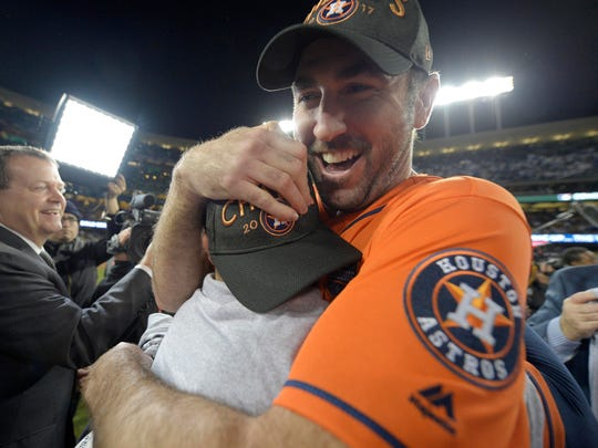 Astros pitcher Justin Verlander (right) and second baseman Jose Altuve (left) celebrate after defeating the Los Angeles Dodgers in Game 7 of the 2017 World Series at Dodger Stadium.