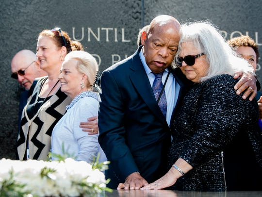 Congressman John Lewis embraces Susan Bro, mother of