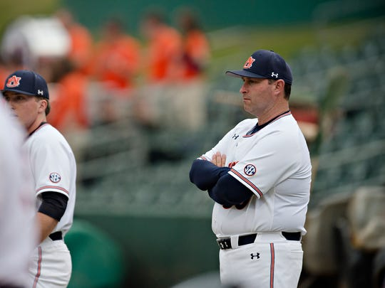 Auburn head coach Butch Thompson looks on before the