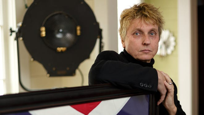 Sons of Confederate Veterans Commander in Chief Michael Givens is photographed in the living of his home in Charleston, S.C., with a large framed Confederate flag he received as a gift for recently speaking at an event in Tennessee.