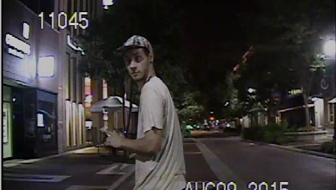 Dashcam image of suspect in case of damaging a police vehicle.