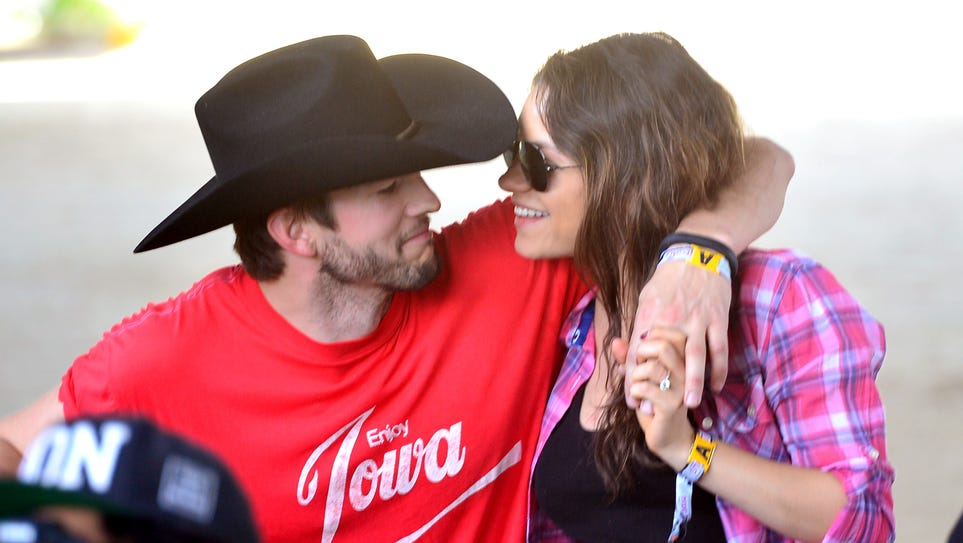 Actors Ashton Kutcher (L) and Mila Kunis attend day 1 of 2014 Stagecoach: California's Country Music Festival at the Empire Polo Club on April 25, 2014 in Indio, California.