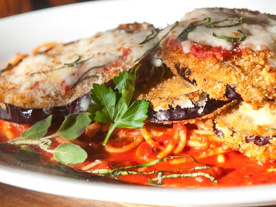 Tomato eggplant Parmesan on pasta served at Ciao.