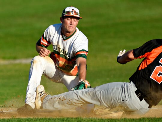 Stoverstown's Nick Todero, right, is out at third during