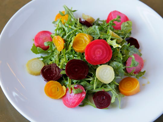 Josh Falzone, consultant chef, prepares a roasted beet salad, made with local honey, arugula and house vinaigrette, in the Farm Barn Cafe at Duke Farms in Hillsborough, NJ Monday June 22, 2016.