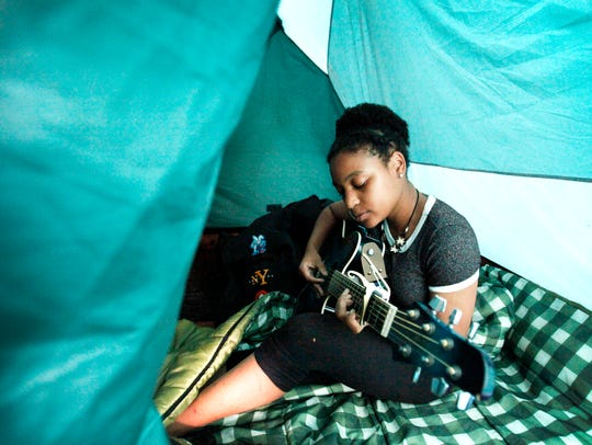 Jessica Johnson, 16, of Raleigh, sings a song she wrote