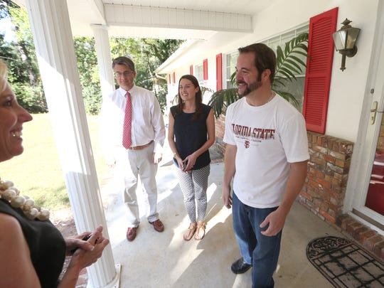 Cecilia Homison, CEO of First Commerce Credit Union, Democrat Publisher Skip Foster and his assistant Shannon Knowles help deliver a new generator Thursday to Jesse Miley, who after 9 days without power, was one of the last people in town to have his utilities restored after Hurricane Hermine.