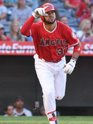 Francisco Arcia  watches his three-run home run clear the fence during the third inning against the Mariners.