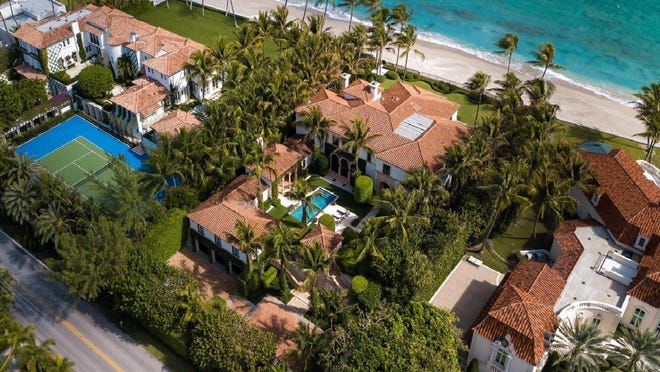 In the center with a courtyard pool, an oceanfront mansion at 1075 N. Ocean Blvd. changed hands in July for a reported $43 million. It was bought by an ownership company controlled by rocker Jon Bon Jovi. The sale was part of a bustling summer for real estate in Palm Beach. [Photo by Dakoda Wright for Andy Frame Photography]