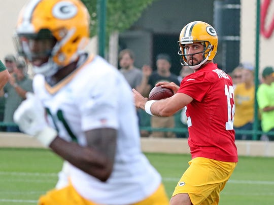 Aaron Rodgers throws to wide receiver Geronimo Allison during training camp.