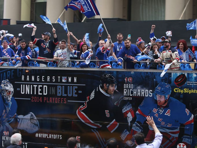 A double-decker bus packed with Rangers fans circles the streets around Madison Square Garden prior to game 3 of the Stanley Cup Finals between the Rangers and Kings June 9, 2014.