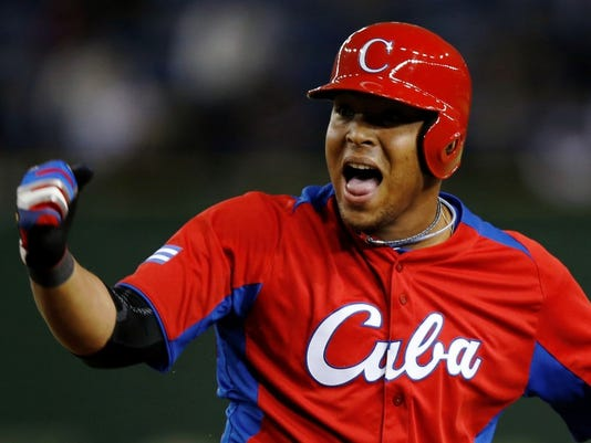 Cuba's Tomas reacts after hitting an RBI single against the Netherlands in the eighth inning at the WBC second round game in Tokyo