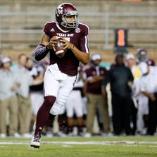 Sep 13, 2014; College Station, TX, USA; Texas A&M Aggies quarterback Kenny Hill (7) scrambles against the Rice Owls  during the first quarter at Kyle Field. Mandatory Credit: Soobum Im-USA TODAY Sports