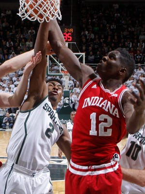 Indiana's Hanner Mosquera-Perea, center right, and Michigan State's Javon Bess, center left, battle for a rebound Jan. 5, 2015, in East Lansing.