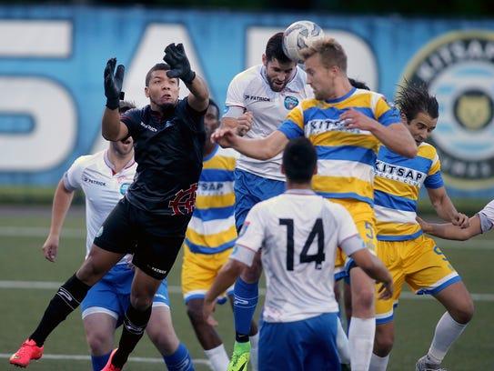Kitsap Pumas player Joe Harris tries to get the ball