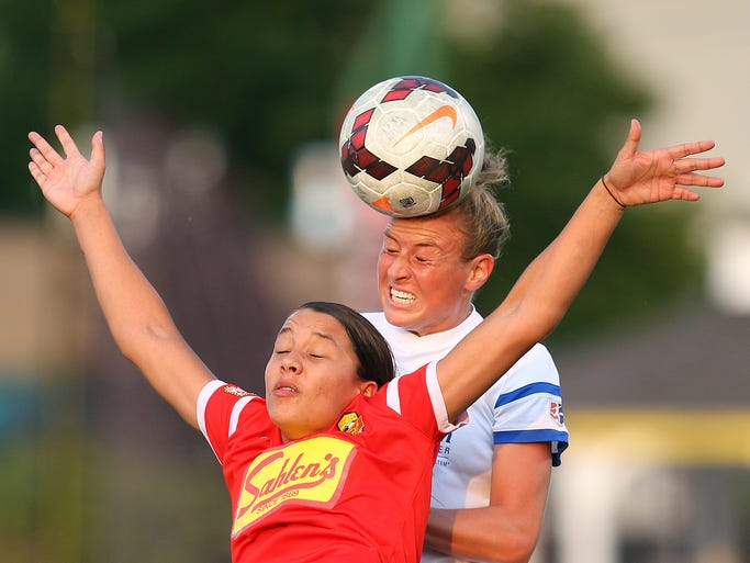 FC Kansas City's Jenna Richmond goes over Flash's Samantha Kerr for a head ball during a 1-1 draw at Sahlen's Stadium Friday.