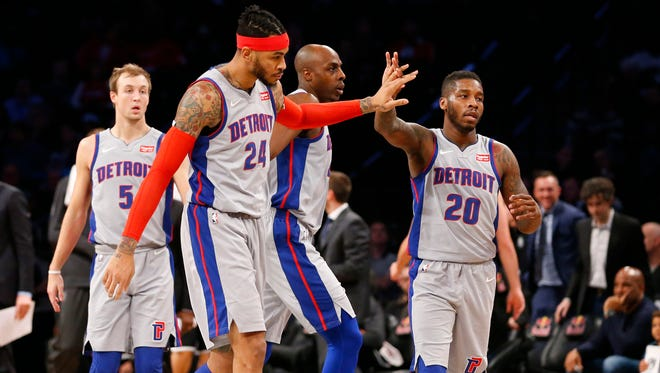 Jan 10, 2018; Brooklyn, NY, USA; Detroit Pistons forward Eric Moreland (24) and Detroit Pistons guard Dwight Buycks (20) reacts after a Brooklyn Nets time out during first half at Barclays Center. Mandatory Credit: Noah K. Murray-USA TODAY Sports