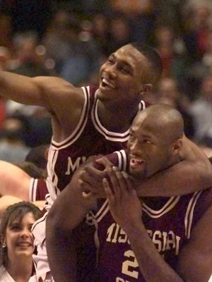 Mississippi State's Darryl Wilson, top, rides on the back of teammate Erick Dampier after they beat Cincinnati 73-63 in the NCAA Southeast Regional final in 1996.